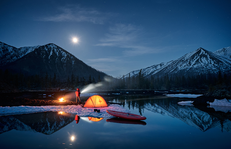 Camping in the mountains at night in the winter
