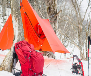 Winter Hammock Camping Sleeping Pad And Backpack In The Snow