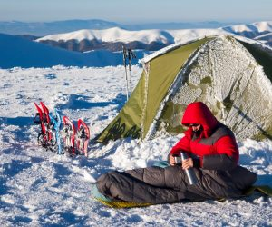 Pouring Hot Water While Winter Camping To Stay Warm