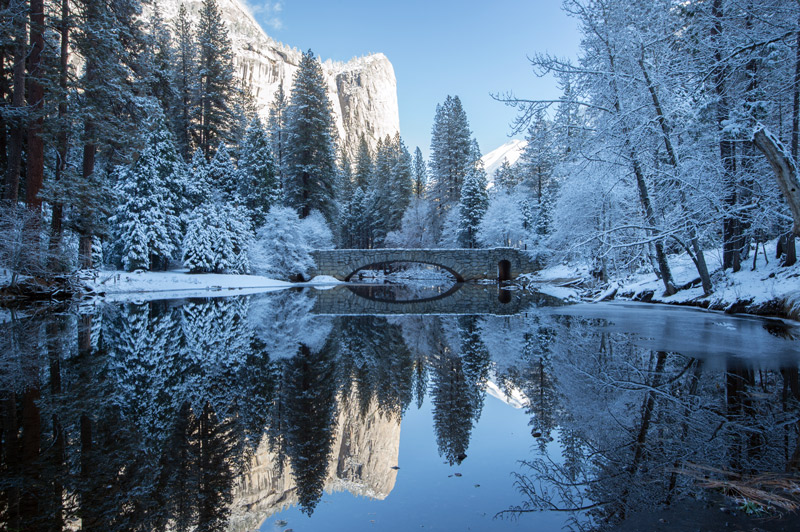 snow reflections on a pond in yosemite national park in winter
