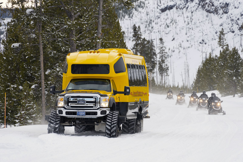 riding a snowmobile through yellowstone national park is one of the top things to do in winter