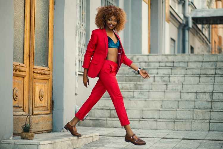 woman wearing red suit and pants outfit