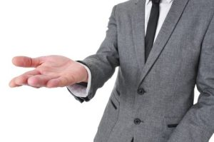 man in suit with his hand open