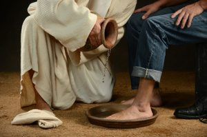 Jesus Washing Feet of Man in Jeans
