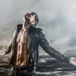 Man looking at stormy sky