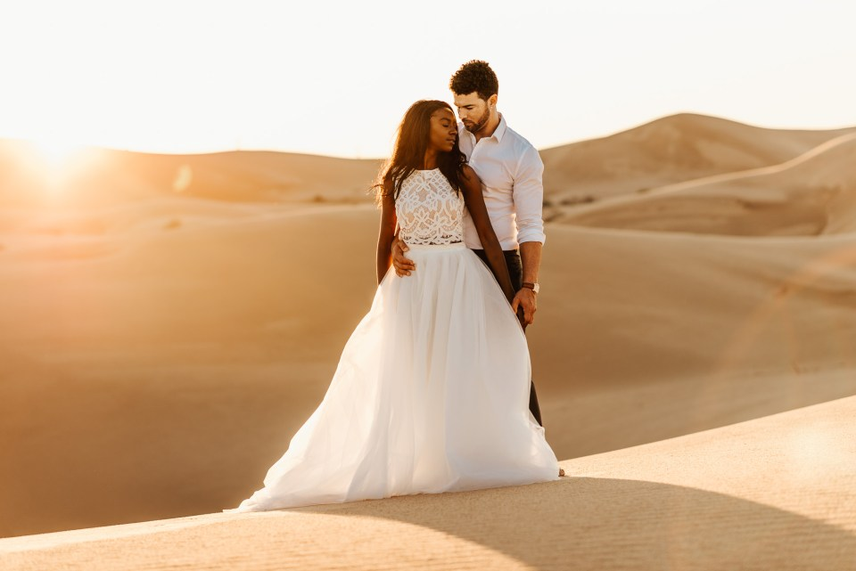 bride and groom at the sand dunes at sunset