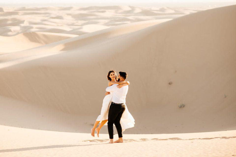 Sand dunes engagement couple