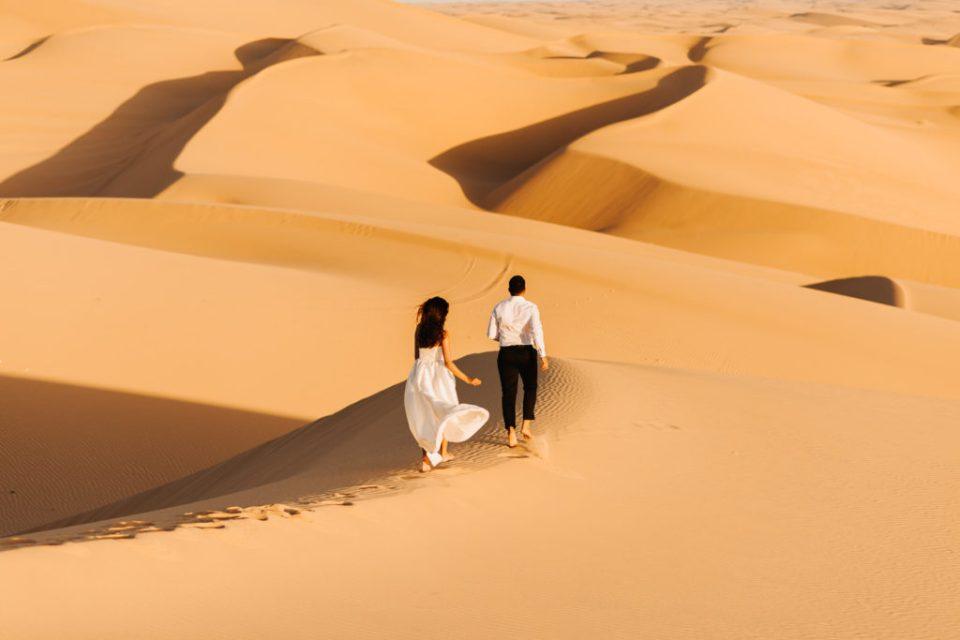 desert sand dunes engagement couple