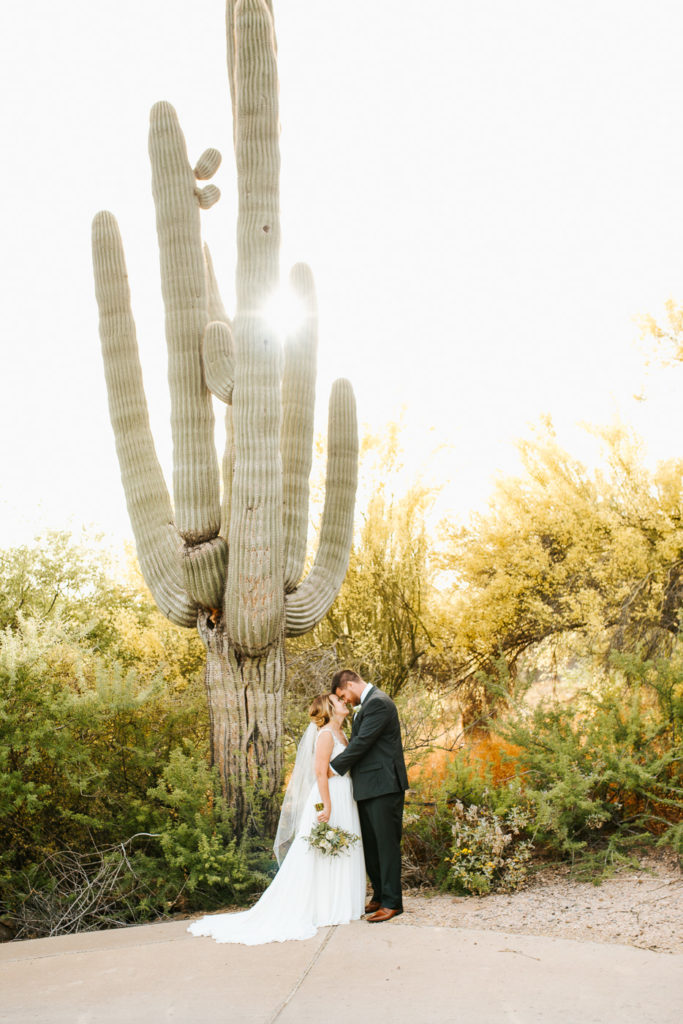 Arizona bride and groom with saguaro