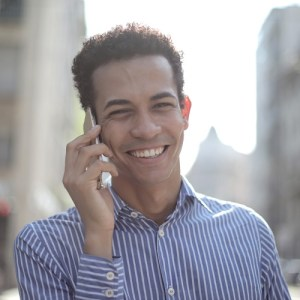 smiling man on phone