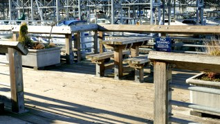 Picnic table to left of pier entrance.