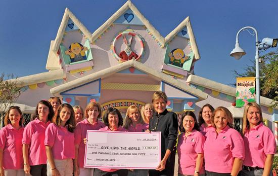 Walt Disney World Moms Panelists Present Donation to Give Kids The World Village