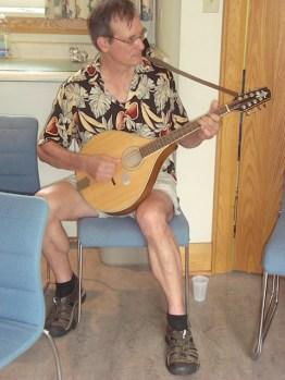 Garden volunteer playing the mandolin