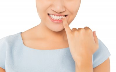 Woman looking in mirror and checking teeth