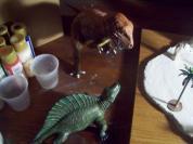 Dinos watch as base is built