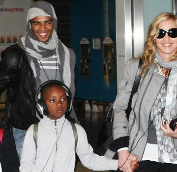 Madonna and Her Boyfriend arrive at Heathrow Airport.