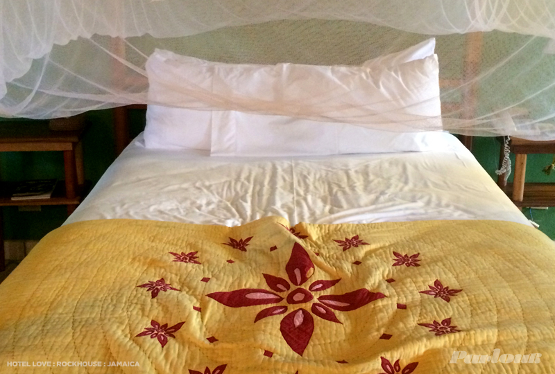 Inside the Standard Deluxe room. All beds have protective mosquito netting and local handmade quilts
