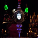 """MADAME LEOTA IN HAUNTED MANSION HOLIDAY (ANAHEIM, Calif.) – Madame Leota, one of the iconic resident spirits, recites """"Thirteen Days of Christmas"""" incantations in the séance scene of Haunted Mansion Holiday. It's part of Halloween Time at the Disneyland Resort, from Sept. 11 through Nov. 1, 2015. This year, the family-friendly Mickey's Halloween Party expands to 17 nights throughout the season at Disneyland park, where guests are invited to trick-or-treat in costume and enjoy special presentations of the """"Halloween Screams"""" fireworks spectacular and the all-new """"Paint the Night"""" parade. Also this fall, the Diamond Celebration continues, with dazzling entertainment and diamond décor."""