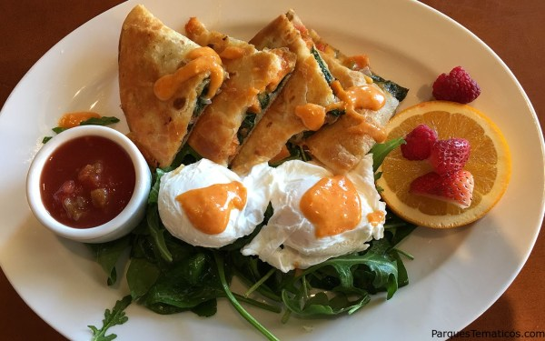 Breakfast Quesadilla – Spinach, Sweet Potato, Onion, Diced Tomato, and Aged Cheddar stuffed in a Tortilla shell. Top it off with two Poached Eggs, Tomato Hollandaise and your choice of Bacon or Sausage.
