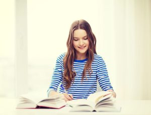 happy smiling student girl with books studying