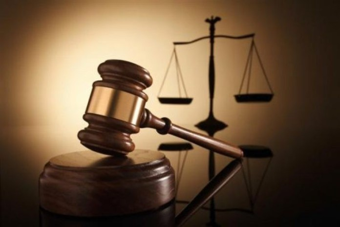 Court arraigns 2 for insulting police officer