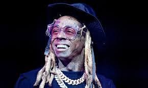Rapper Lil Wayne charged with weapons possession, risks 10 years in jail