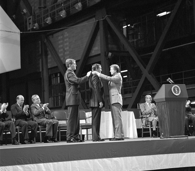 (Oct. 1, 1978) Astronaut Neil Armstrong received the first Congressional Space Medal of Honor from President Jimmy Carter, assisted by Captain Robert Peterson. Armstrong, one of six astronauts to be presented the medal during ceremonies held in the Vehicle Assembly Building, was awarded for his performance during the Gemini 8 mission and the Apollo 11 mission when he became the first human to set foot upon the moon.