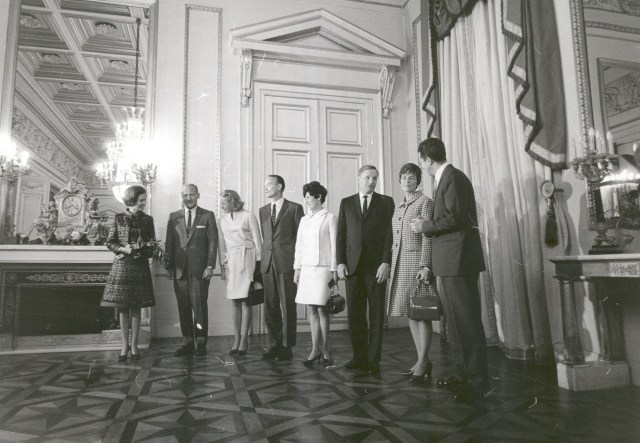(October 9, 1970) The King of Belgium, Baudouin I, and his Queen, Fabiola, pose along with the Apollo 11 astronauts and their wives in the reception hall of the Royal Palace in Brussels, Belgium.