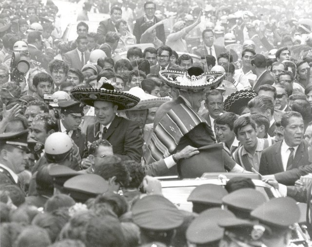 (Sept. 23, 1969) The Apollo 11 astronauts, Neil A. Armstrong, Edwin E. Aldrin, Jr., and Michael Collins, wearing sombreros and ponchos, are swarmed by thousands in Mexico City as their motorcade is slowed by the enthusiastic crowd. The GIANTSTEP-APOLLO 11 Presidential Goodwill Tour emphasized the willingness of the United States to share its space knowledge. The tour carried the Apollo 11 astronauts and their wives to 24 countries and 27 cities in 45 days.