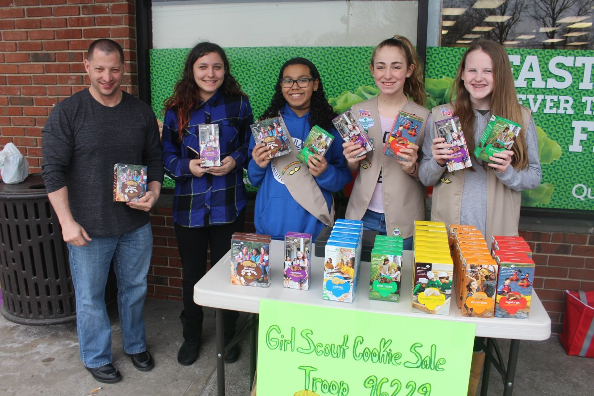 Girl Scouts Troop 6229 selling cookies at QuickChek