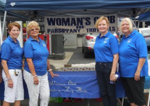 Club members after setting up Woman's Club of Parsippany Troy Hills booths at Parsippany's Annual Fall Festival.  Fr left: Club member Janet Reilly, club President Marilyn Marion, and club members Vicki Golden and Joan Garbarino.