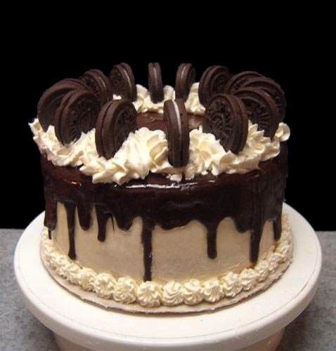 Oreo Extravaganza Cake. A ribbon of oreo cookie crumbs are baked into each layer!