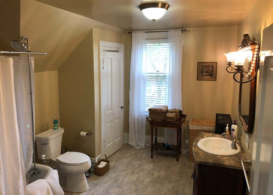 tub, toilet, lavatory, and towels in third floor bathroom