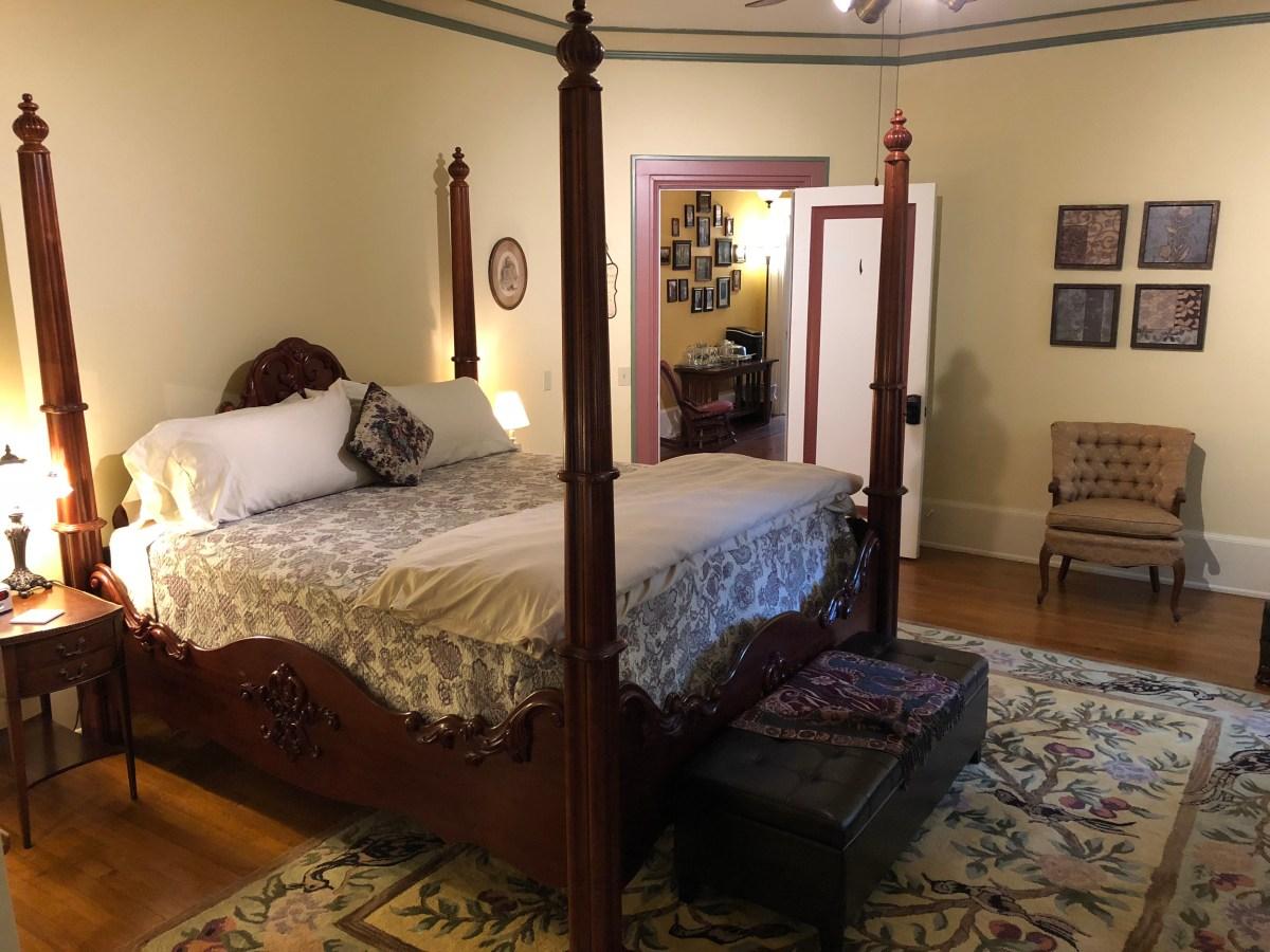 four poster bed in front of doorway