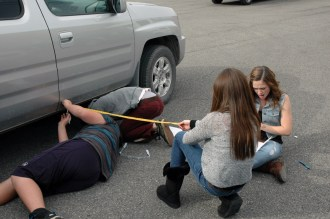 Eighth graders find measurements for the PT Cruiser