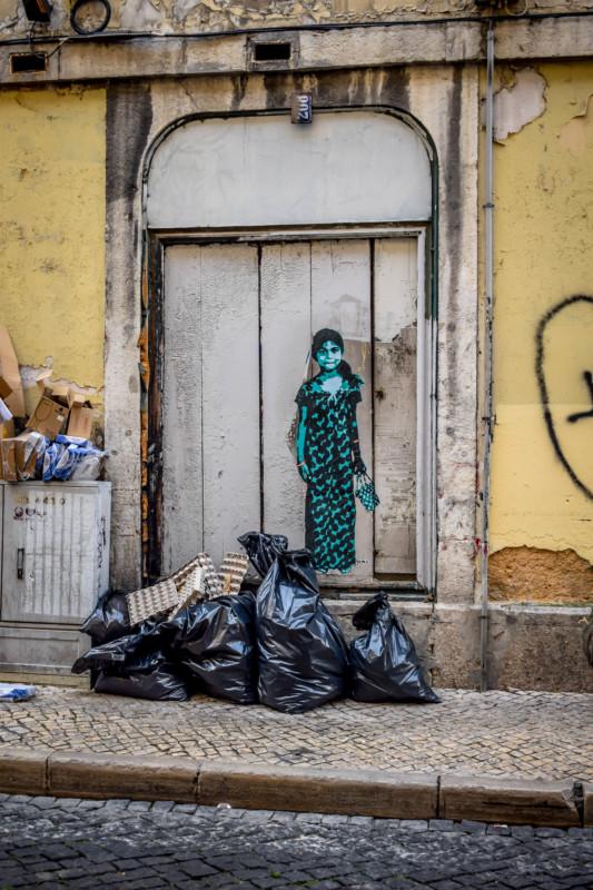 lisbon street art painting of girl on door in Bairro Alto