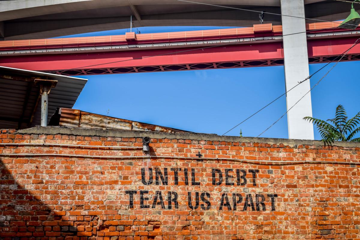 Lisbon street art LX Factory Until debt tear us apart