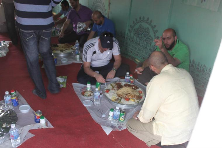 Haitham Raba (with blue cap; from Jordan), Eyad Quwwar (in green T-Shirt; from Egypt) and Imran Mehmood (from Pakistan) sharing one tray.