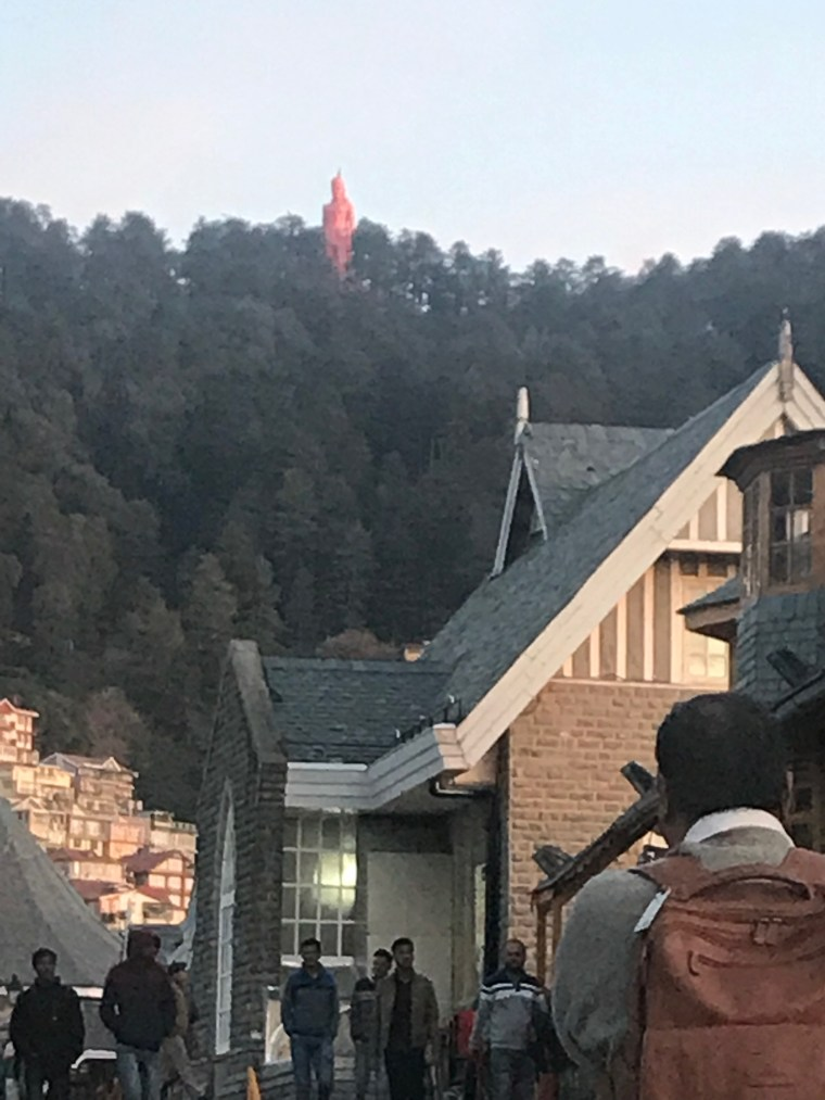 On the way to the Radisson Jazz, we could see the Hanuman Temple on top of the Hill. The pink could status of Lord Hanuman can be seen this photograph.