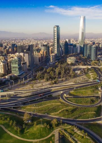 Aerial view of road jungtion and Manquehue hill from Vitacura bicentennial park on a clear day in