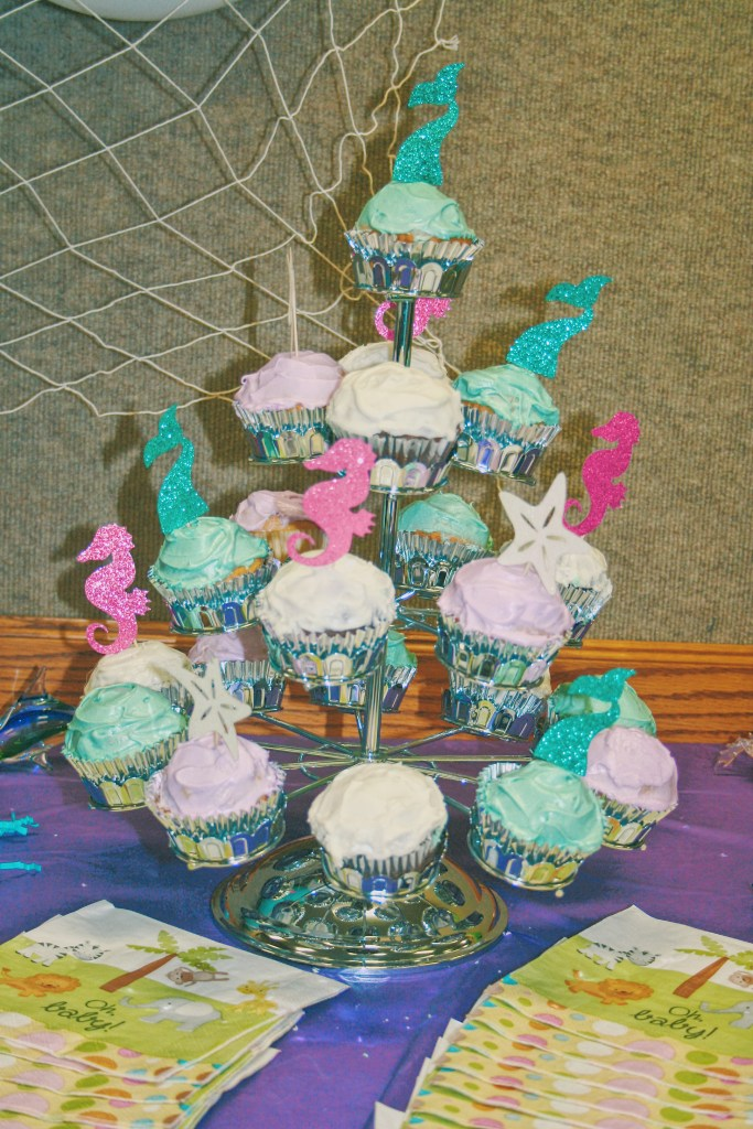 Cute DIY Under the Sea Baby Shower Ideas Cupcake Toppers and Cupcake Display on Dessert Table