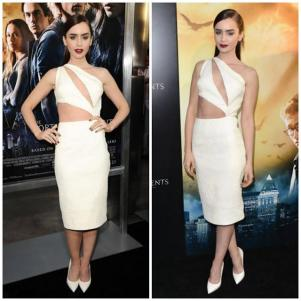 In a sexy, subtle white cut-out dress, another hot trend that's still going strong.