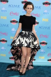 Lily turned heads in this Fausto Puglisi high-low dress. Wearing bold prints was one of the trends that summer.
