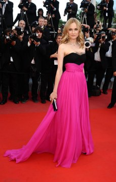 Diane Kruger in a fuchsia and black dress.
