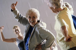 Group of senior women exercising in a health club