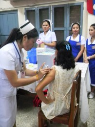 4.23 - Vientiane - MCH - Pregnant woman receiving vaccine (yellow flowers)