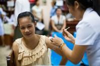 4.23 - Vientiane - MCH - UPS - woman being vaccinated (beige ruffles)