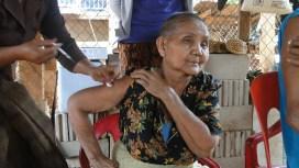 4.27 - Champasack prov. 5 - elderly woman getting vaccinated black flower shirt