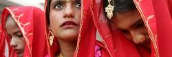 Pakistani brides sit during a mass wedding ceremony in Karachi January 21, 2006. The Women Development Foundation paid for the marriages of 50 low income couples by arranging for donations in kind and cash from various groups. Marriages traditionally incur huge expenses in the south-Asian country. REUTERS/Athar Hussain - RTR18LK9