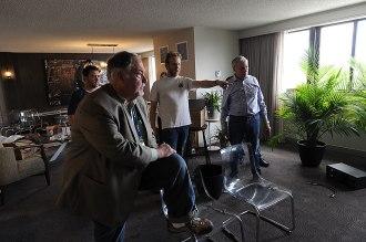 Bill Leebens, left, Paul and Scott McGowan, right, during set up.
